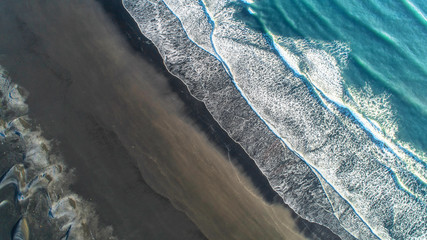 Panel SzklanyThe black sand beach in Iceland. Aerial view and top view. Beautiful natural backdrop.