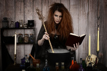 Witch In Her Cottage Making A Magic Potion