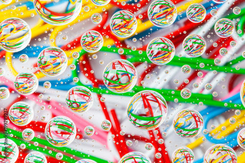 Foto op Plexiglas Snoepjes Color background with water drops and paper clips