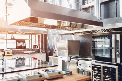 Professional kitchen of restaurant. Modern equipment and devices. Empty kitchen in the morning.