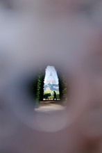 Famous Aventine Keyhole (Il Buco Della Serratura). View Of St Peter's Basilica Through The Keyhole. Priory Of The Knights Of Malta. Peasant With A Cart On The Background Of The Basilica. Rome, Italy