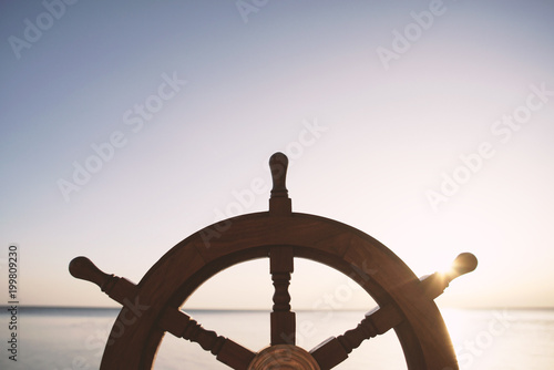 Fotografia  Ship rudder with sea on background.