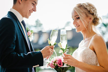 Newlyweds Holding Glasses Of C...