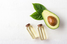 Avocado Oil On White Wooden Ba...