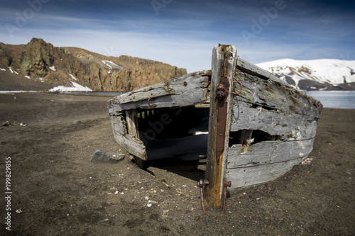 Fotografie, Obraz  An old boat sits on the warm volcanic beaches of Deception Island in Antarctica