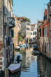 Colourful and relaxing canal in Venice, Veneto, Italy.