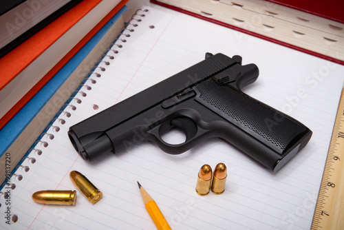 Fotografía  Firearm and Bullets with Textbooks