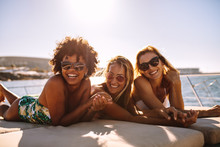 Cheerful Women Sunbathing On Private Yacht