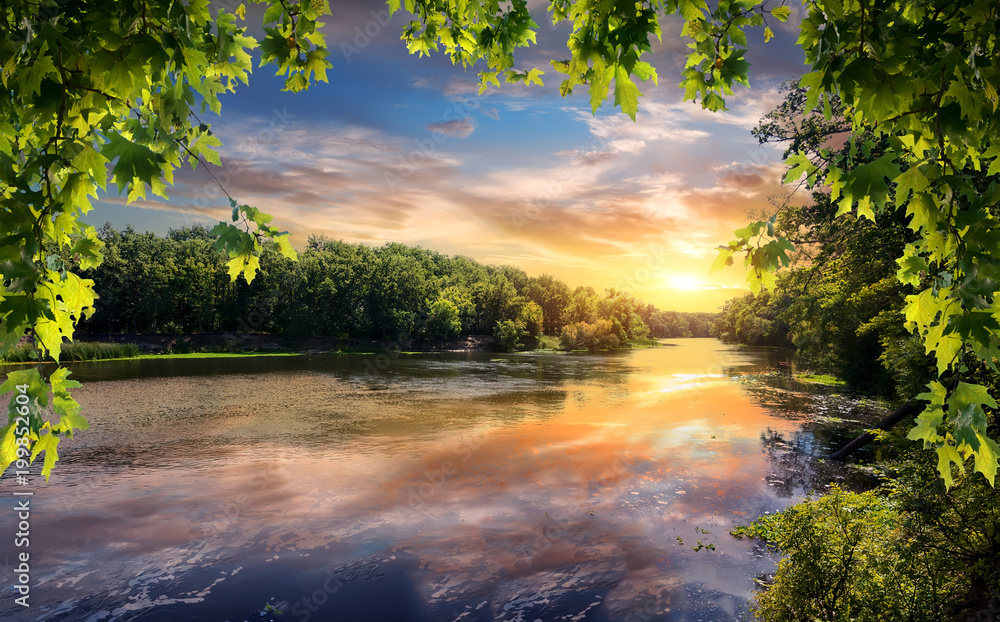 Fototapety, obrazy: Reflection of sunset in river