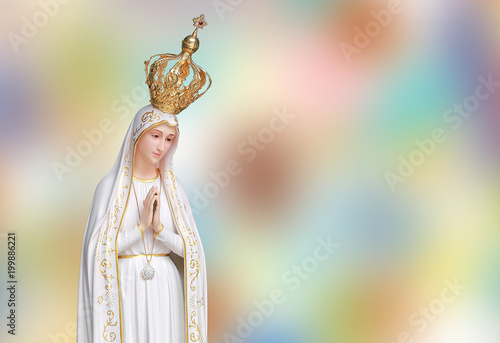 Fotografiet Statue virgin Mary Fatima of the Catholic Church on blur colorful background