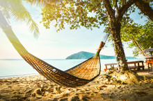 Empty Hammock Between Palm Trees On Tropical Beach. Paradise Island For Holidays And Relaxation.
