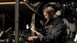 mechanic with the list in stock of used auto parts