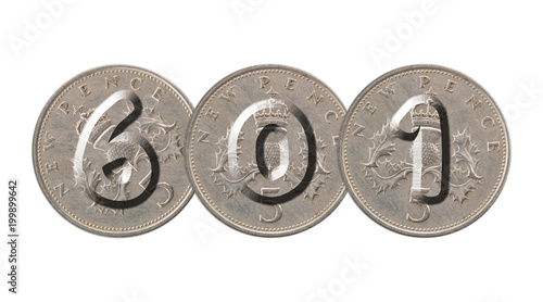 Fotografia  Number 601  with old coins on white background