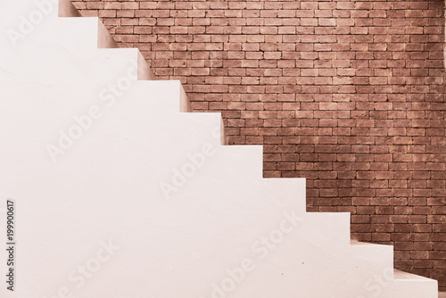 Photo Stands Stairs Concrete Staircase with brick wall in residential house building of construction industry