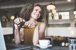 Portrait of beauty and smiling curly hair woman in city cafe, drinking coffee and holding eyeglass