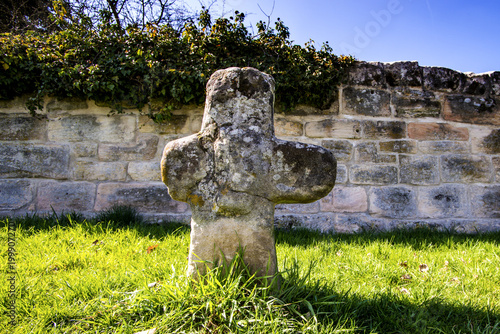 penitence cross with old medieval abbey wall Wallpaper Mural