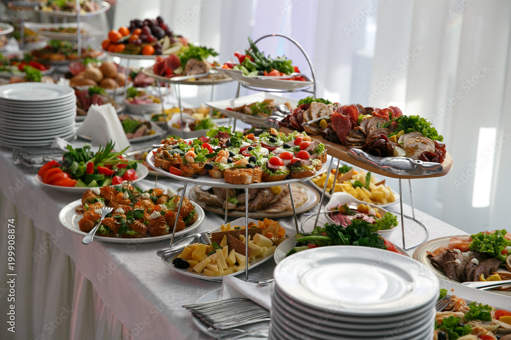 Fototapeta Catering service. Restaurant table with snacks food at event.