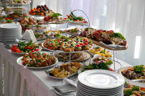 Fototapeta Catering service. Restaurant table with snacks food at event. obraz