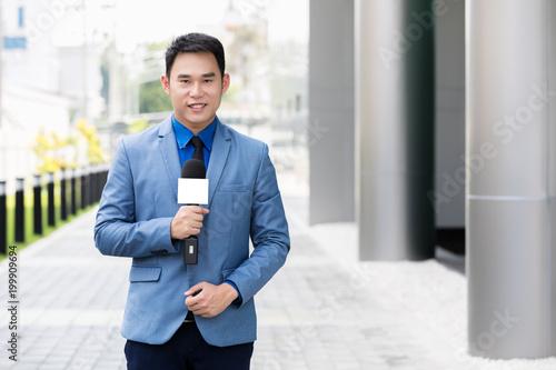 Valokuva  professional news reporter live broadcasting on urban street