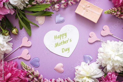Mothers day greeting message with peonies gift box and decorative mothers day greeting message with peonies gift box and decorative hearts on violet background m4hsunfo