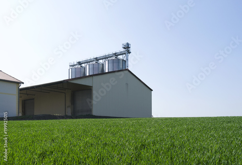 Agriculture: Round grain silo - Buy this stock photo and