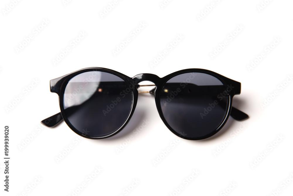 Fototapeta Stylish black sunglasses isolated on white background, top view