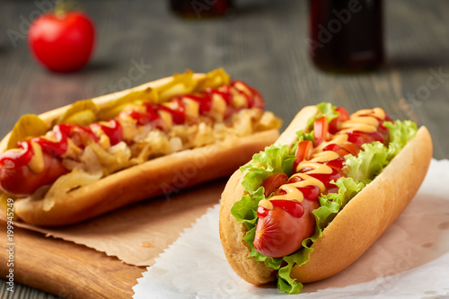 Fotografie, Obraz  Two juicy hot dogd with vegetables