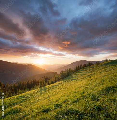 Foto auf Gartenposter Hugel Sunset in the mountain valley. Beautiful natural landscape in the summer time