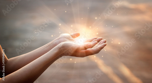Fotografie, Obraz  Woman hands praying for blessing from god on sunset background