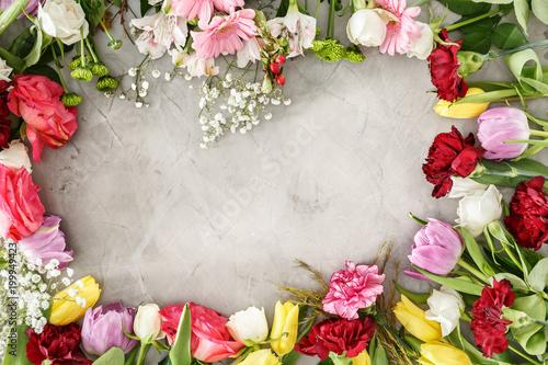 Foto op Plexiglas Tulp Colorful flowers on gray table