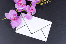 Blank Mourning Card With Orchids As Decoration On Black Background