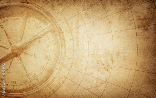 Old vintage retro compass on ancient map Fototapet