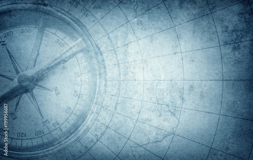 Wall Murals Northern Europe Old vintage retro compass on ancient map. Survival, exploration and nautical theme grunge blue background