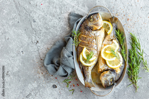 Foto op Plexiglas Vis Baked fish dorado. Sea bream or dorada fish grilled