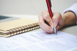 attractive business woman hands use pen signing on paper or writing note or examination test on table at outdoor.