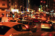 Car traffic in west part of famous Gran Via, main street in Madrid. Evening shot with city lights