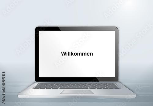Laptop auf Holztisch - Willkommen Canvas Print
