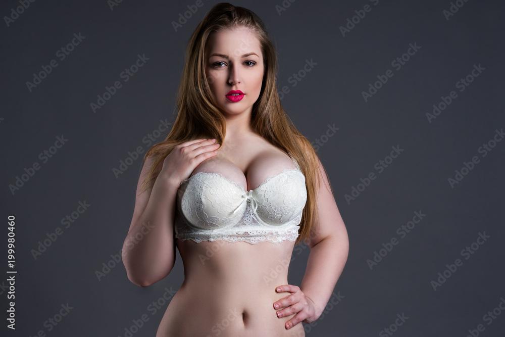 Plus size sexy model in white bra, fat woman with big natural breast on  gray stu Fotografia, Obraz na Posters.sk