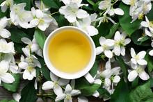 Cup Of Green Jasmine Tea On Ja...