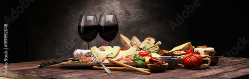 Poster Wine Italian antipasti wine snacks set. Cheese variety, Mediterranean olives, pickles, Prosciutto di Parma with melon, salami.