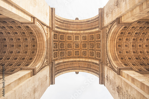 Valokuva  The Arc de Triomphe in paris, seen from below