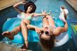 Beautiful women relaxing in swimming pool