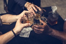 Diverse Hands Clinking Alcohol...