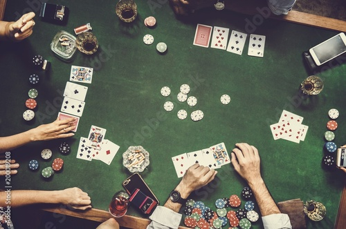 фотография  Group of people playing gambling together