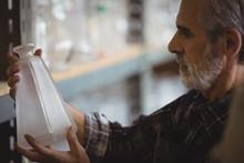 Glassblower Examining Glassware