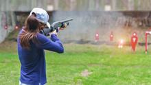 Woman In Practice Shooting Gun...