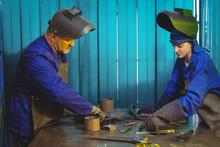 Male And Female Welders Workin...