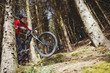 Mountain biker jumping with bicycle in woodland