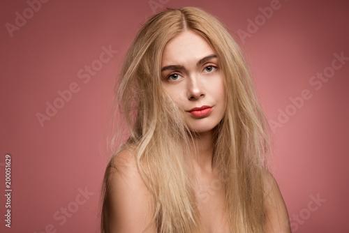Fotografie, Obraz  Portrait of sad girl having disheveled and unhealthy locks