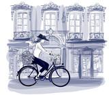 Szczęśliwy młody rowerzysta jedzie na ulicy w Paryżu z małym psem - 200052052